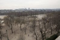A GAME OF REFLECTIONS AND MIRRORS ON CHAMPS DE MARS IN PARIS